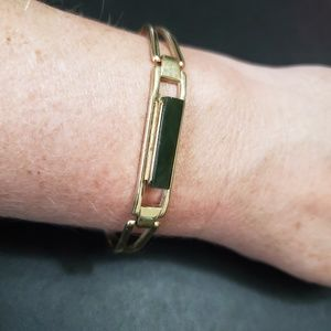 Avon green and gold tone bracelet